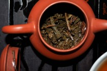wet aged pu erh leaves in a teapot